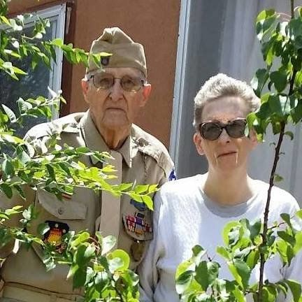 A fundraiser is underway for decorated WWII veteran Dennis Ferk (pictured with his daughter, Denise) after two of his caregiv