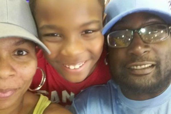 An undated photo of Keith Lamont Scott with wifeRakeyia and one of their children
