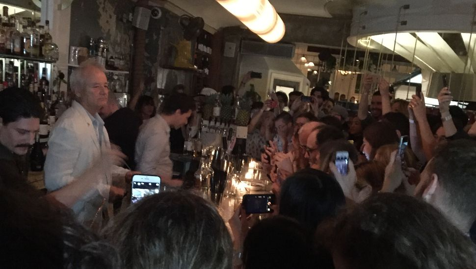 Bill Murray tends bar at 21 Greenpoint in Brooklyn, New York.