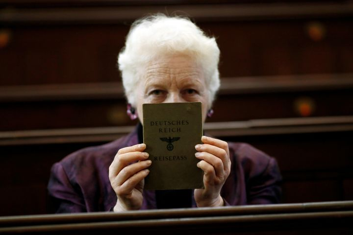 London rabbi Julia Neuberger poses for a photograph with the old German passport of her grandmother, Hermine Sara Rosenthal,