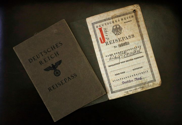 The old German passports of Ludwig (L) and Hermine Sara Rosenthal, the grandparents of London rabbi Julia Neuberger, are seen