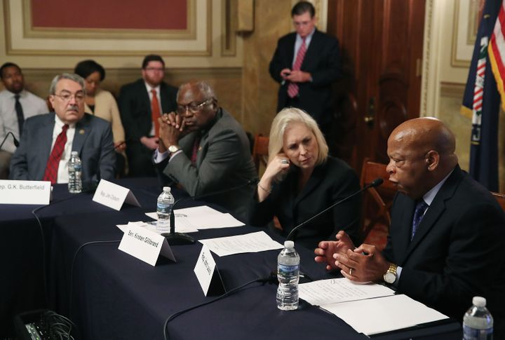 Sen. Kirsten Gillibrand (D-N.Y.), listens to Rep. John Lewis (D-Ga.), speak during a discussion on the state of voting rights