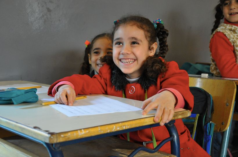 Refugee Syrian Children attending a double-shift school in Lebanon