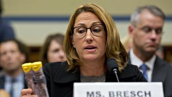 Heather Bresch, chief executive officer of Mylan NV, holds up Mylan EpiPen medication while speaking during a House Oversight and Government Reform Committee hearing in Washington, D.C., U.S., on Wednesday, Sept. 21, 2016. Lawmakers are questioning Bresch about how the company raised the price of the life-saving injection to $600 for a two-pack, from $57 a shot when it took over sales of the product in 2007. Photographer: Andrew Harrer/Bloomberg via Getty Images