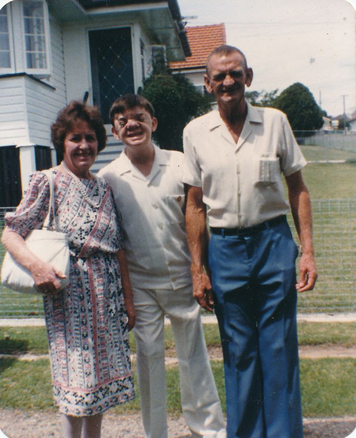 Robert with his parents.