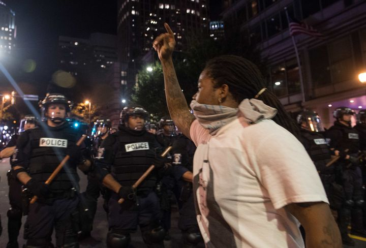 Protesters face riot police during a demonstration against police brutality in Charlotte, North Carolina, on September 21, 20