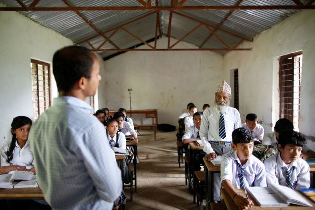 Durga Kami answers a question from his teacher at Shree Kala Bhairab Higher Secondary School...