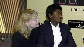 NEW YORK, UNITED STATES:  US Actress Mia Farrow (L) and her adopted son Thaddeus, whos suffers from polio (C), talk with media mogul Ted Turner (R) before a United Nations conference on the eradication of polio in New York, New York 27 September, 2000. Thaddeus Farrow pushed the button on top of the stand at right which started a count down to the time of a polio-free world in 2005.  AFP PHOTO/ Henny Ray ABRAMS (Photo credit should read HENNY RAY ABRAMS/AFP/Getty Images)