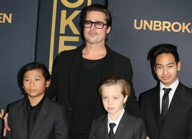 Brad Pitt and children Pax Thien Jolie-Pitt, Shiloh Nouvel Jolie-Pitt and Maddox on the red carpet...