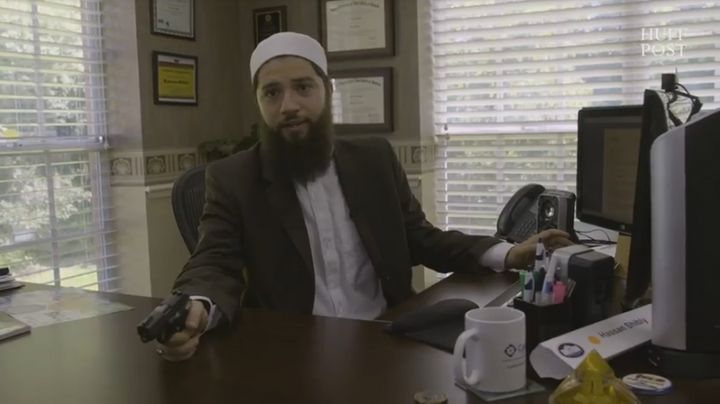 Hassan Shibly at his office, with theSig Sauer P238 he bought in July.