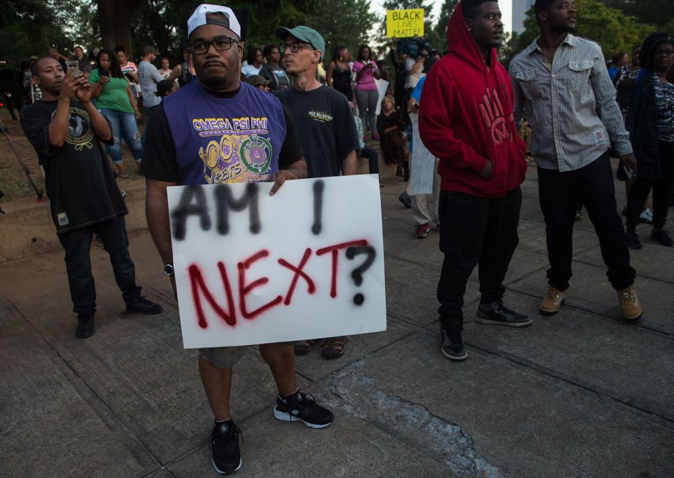 Protesters attend a demonstration against police brutality.