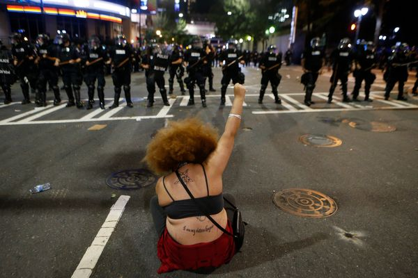 Police clash with demonstratorsas residents and activists protest the police shooting death of Keith Scott.