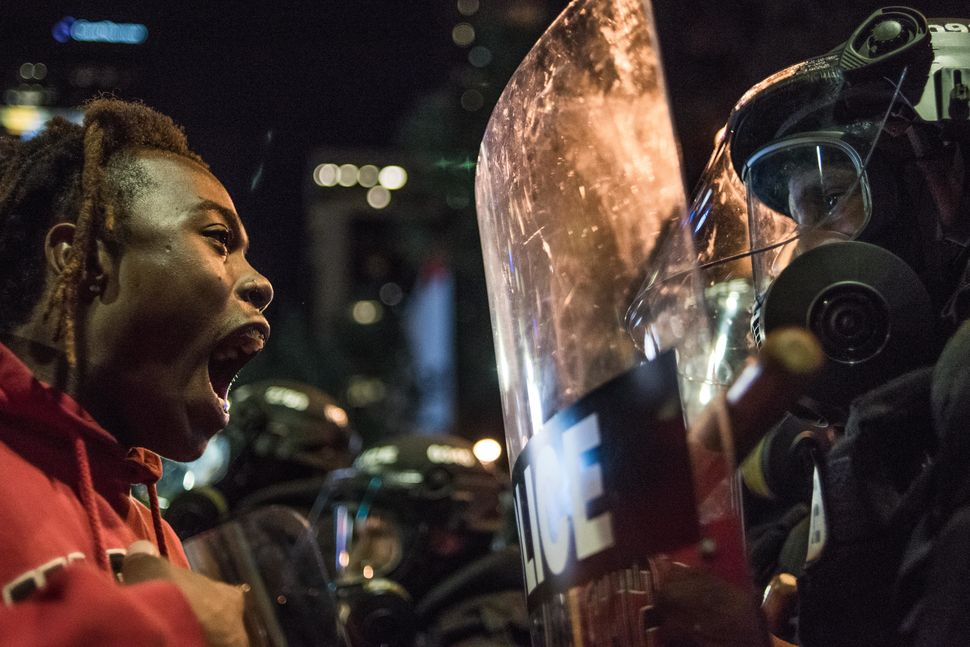 A demonstrator comes face to face with law enforcement during protests.