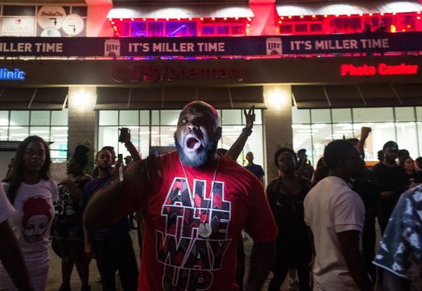 A protester chants during a demonstration against police brutality.