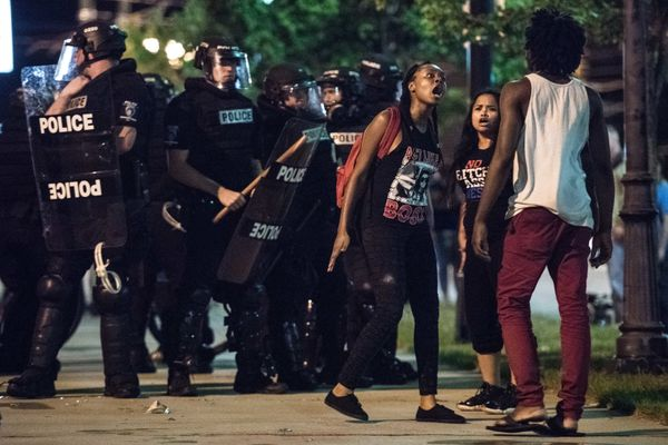 Demonstrators argue amongst themselves during protests.