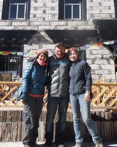 When two solo female travelers meet, magic happens.  We took a photo with our hostel innkeeper, Andy, before leaving Yading N