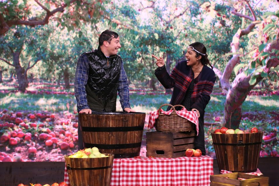 Actress Priyanka Chopra and Jimmy Fallon bob for apples on September 21, 2016.