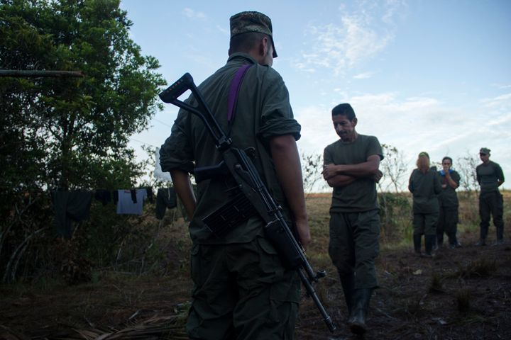 Guerrillas from FARC EP meet in the early morning to get to work in Llanos del Yari, a town in an Indigenous region of southe