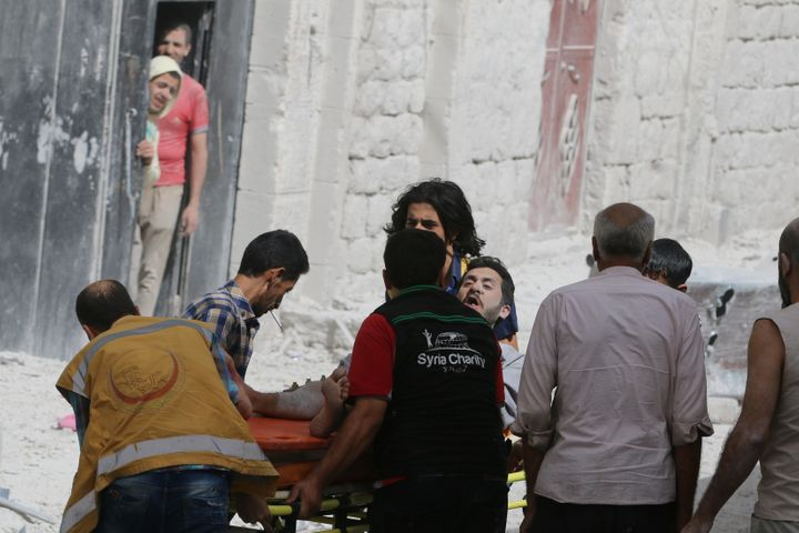 A man reacts while being carried on a stretcher after airstrikes on the rebel held al-Qaterji neighbourhood of Aleppo, Syria