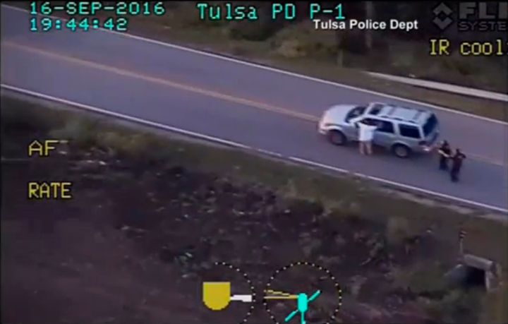 A still image captured from a video from Tulsa Police Department shows Terence Crutcher seen with his hands in the air during
