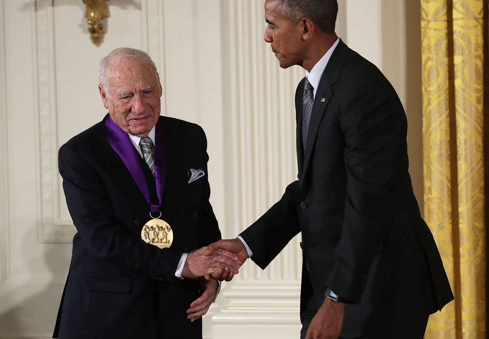 U.S. President Barack Obama (R) presents the National Medal of Arts to comedian Mel Brooks (L) during an East Room ceremony a