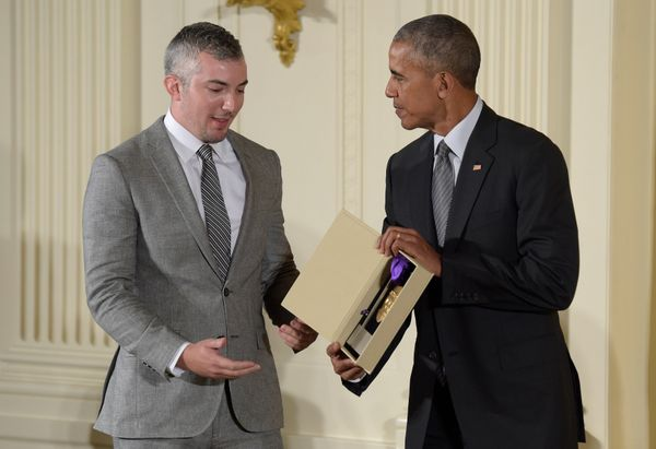 President Barack Obama presents Preston Whiteway, executive director of the Eugene O'Neill Theater Center with the 2015 Natio