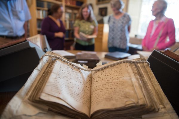 A 14th century service book is seen displayed at the library.