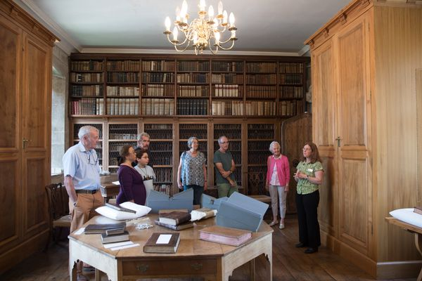 Cathedral Archivist Emily Naish (R) talks to members of the public visiting the library.Today, the Library holds approx