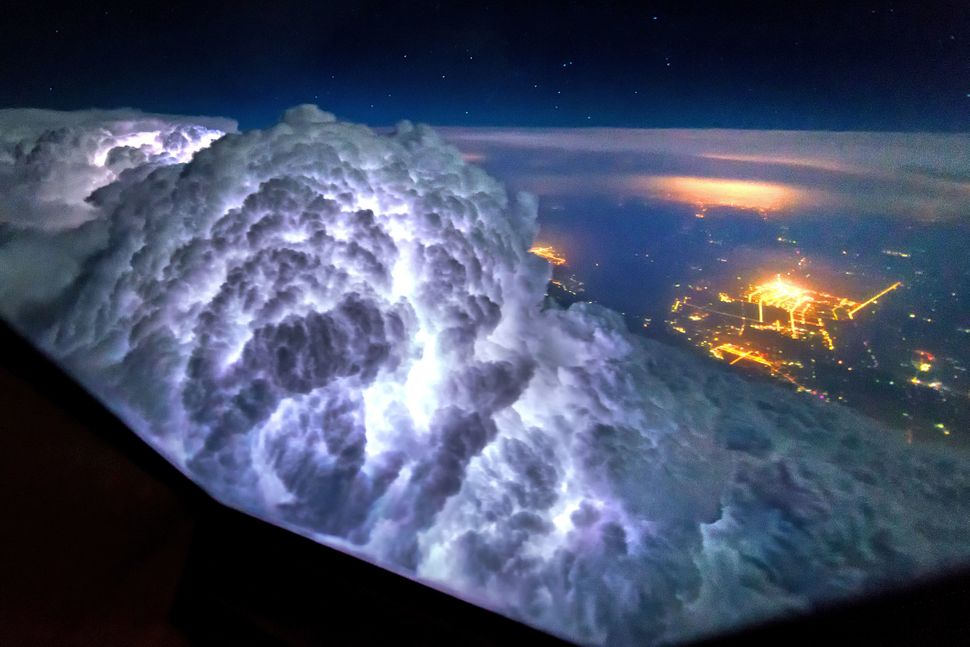 Thunderstorms light up the insides of clouds.