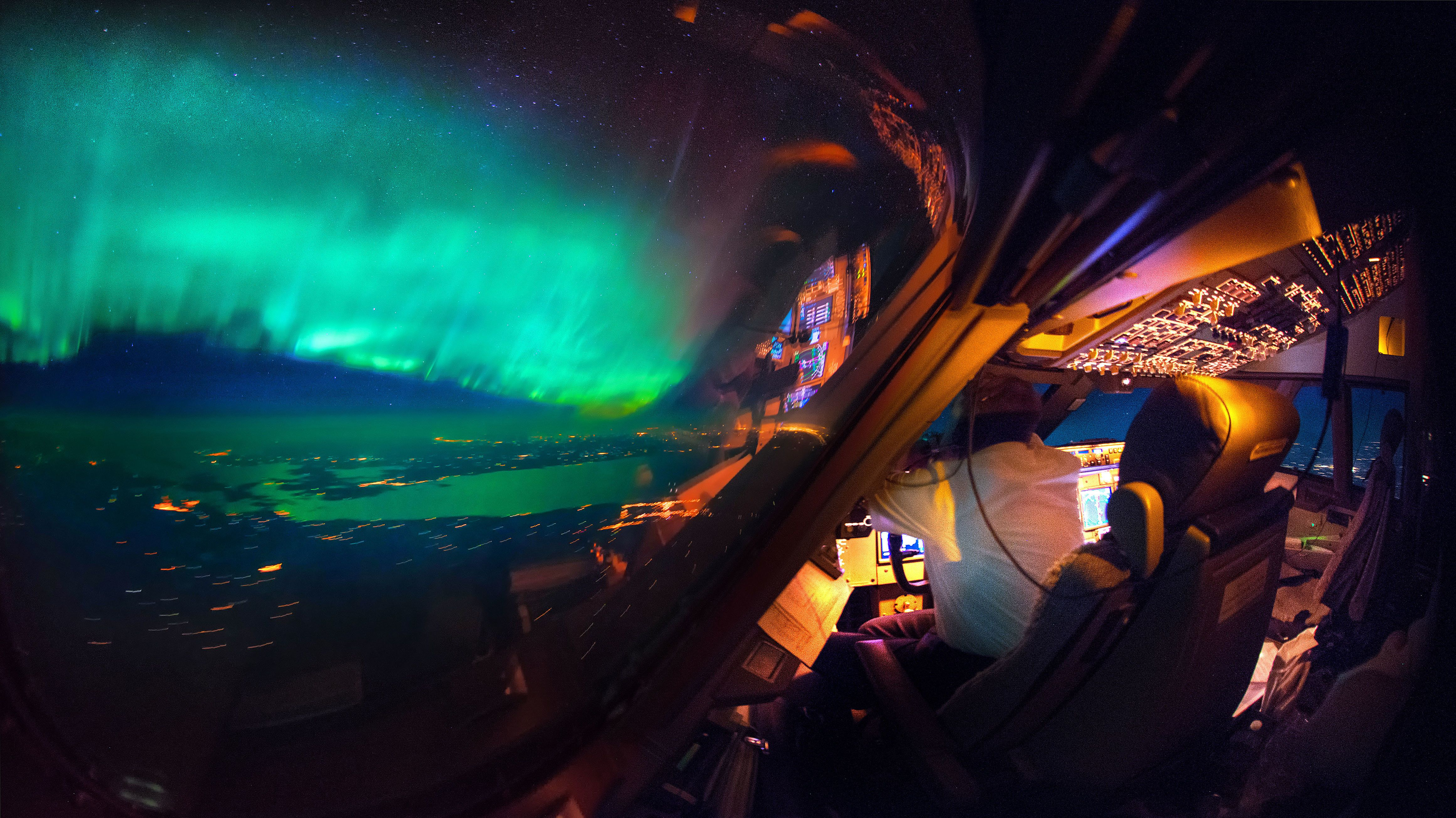 An amazing view of the northern lights from the cockpit.