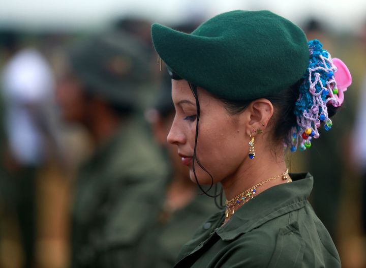 A FARC fighter stands in line during the opening of ceremony congress at the camp where they prepare for ratifying a pea