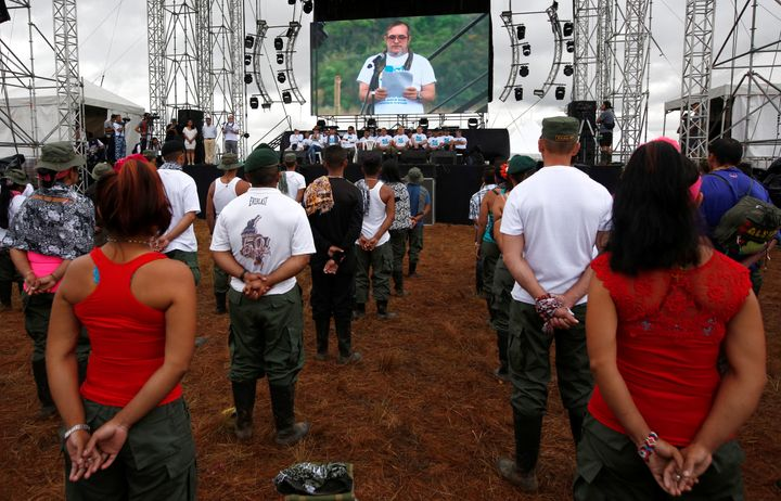 FARC rebel leader Rodrigo Londono is seen on a screen during the opening of ceremony congress at the camp.