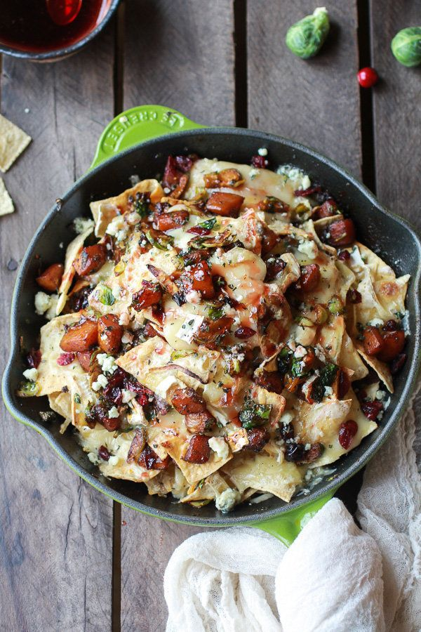 """<strong>Get the <a href=""""http://www.halfbakedharvest.com/cranberry-butternut-brussels-sprout-brie-skillet-nachos/"""" target=""""_b"""