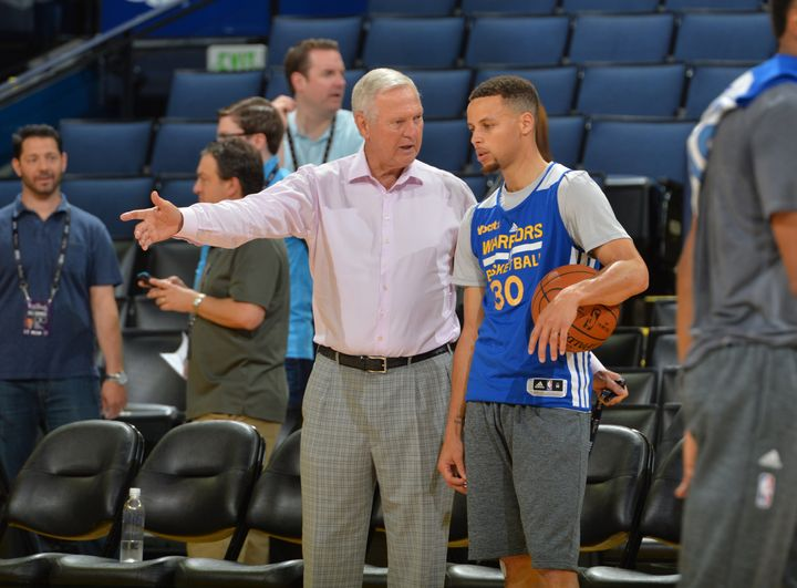 NBA Hall of Famer Jerry West speaking with the league's reigning two-time MVP Stephen Curry during the NBA Finals.