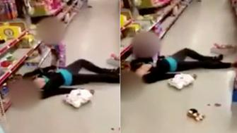 Video shows mom passed out on floor of store as toddler cries