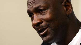 Charlotte Hornets owner Michael Jordan responds to a question during a news conference on on Tuesday, Oct. 28, 2014, at Time Warner Cable Arena in Charlotte, N.C. (Jeff Siner/Charlotte Observer/MCT via Getty Images)