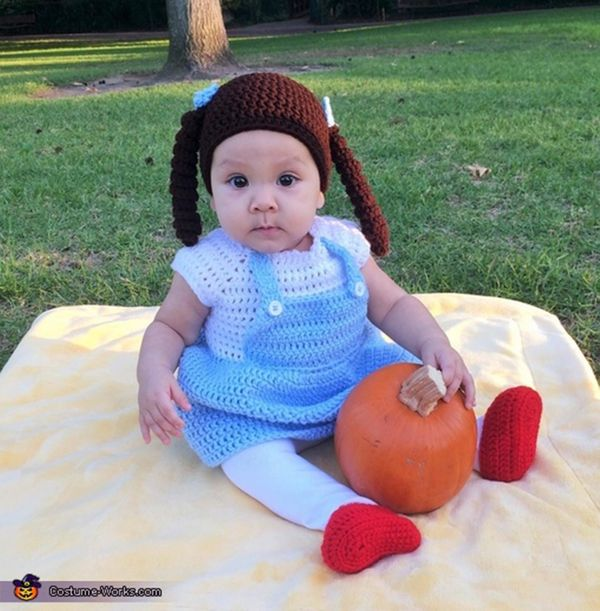 "Via <a href=""http://www.costume-works.com/costumes_for_babies/knitted-dorothy.html"" target=""_blank"">Costume Works</a>"