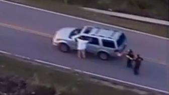 A still image captured from a video from Tulsa Police Department shows Terence Crutcher seen with his hands in the air during a police shooting incident in Tulsa, Oklahoma, U.S. on September 16, 2016. Video taken September 16, 2016.  Courtesy Tulsa Police Department/Handout via REUTERS    ATTENTION EDITORS - THIS IMAGE WAS PROVIDED BY A THIRD PARTY. EDITORIAL USE ONLY