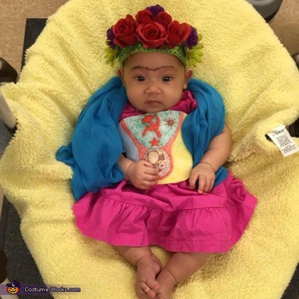 "Via <a href=""http://www.costume-works.com/baby-frida-kahlo2.html"" target=""_blank"">Costume Works</a>"