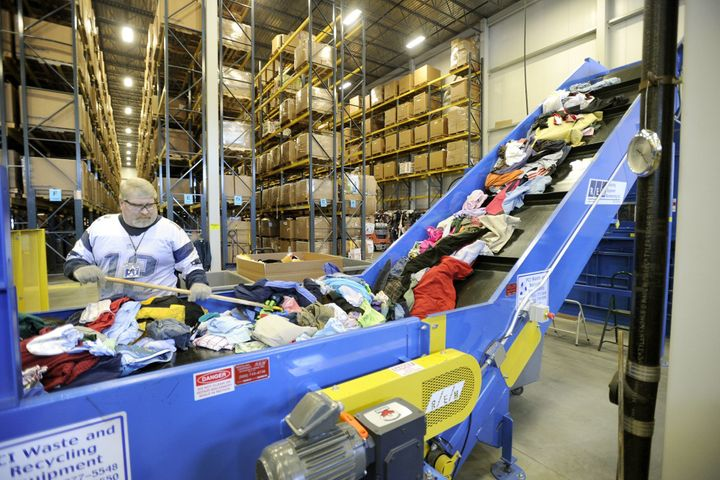 A worker prepares clothes for a Goodwill outlet in Portland, Maine