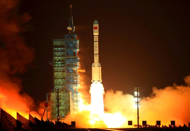 China's rocket carrying the Tiangong-1 module, or 'Heavenly Palace', blasts off from the Jiuquan launch...