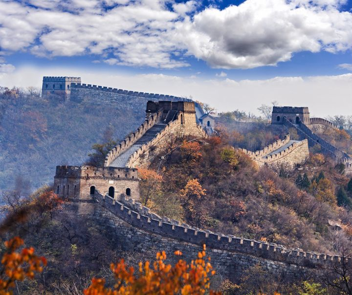 Several towers of the Great Wall of China near Mutianyu, north ofBeijing, high in mountains at autumn.