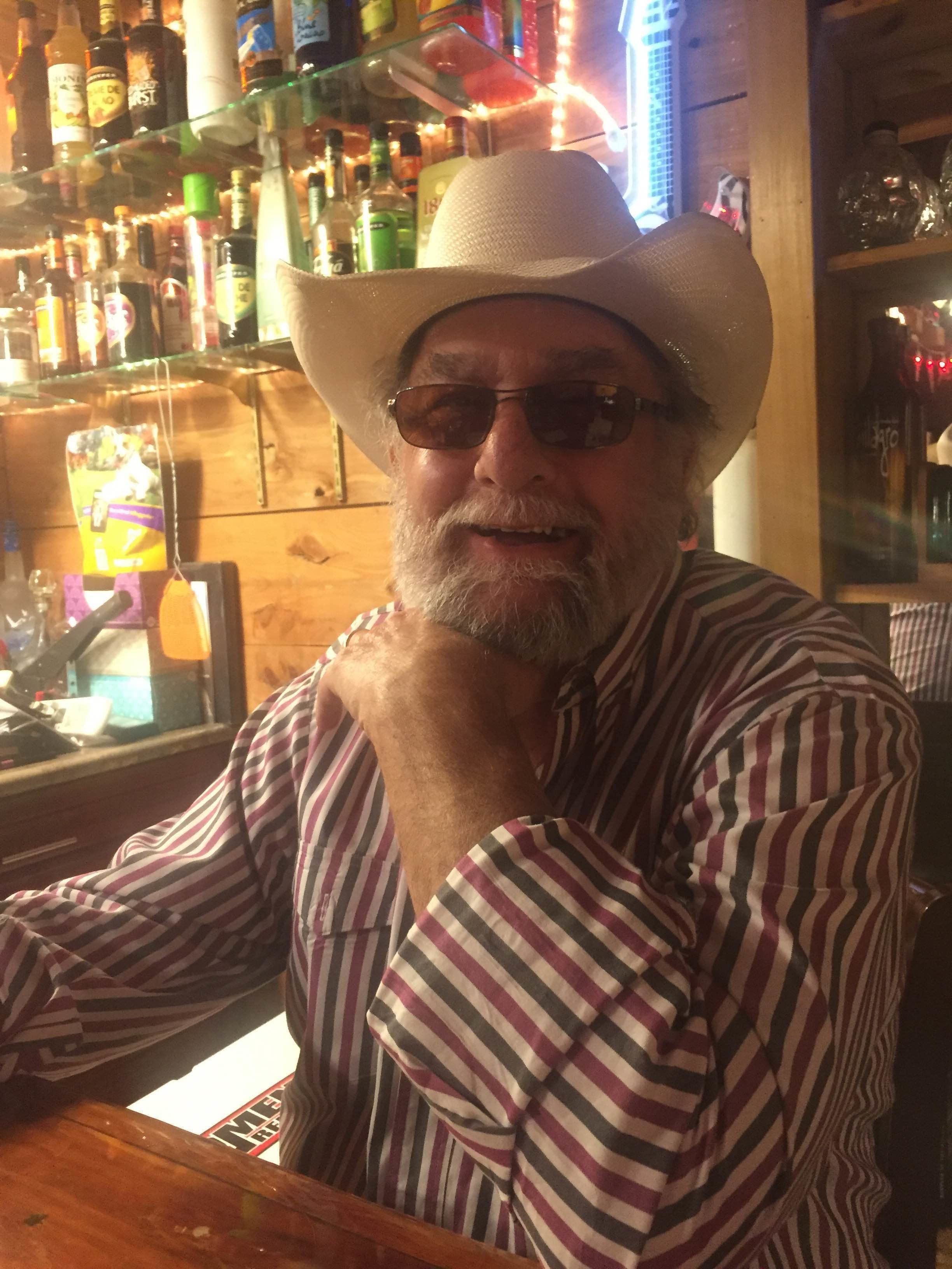 """Howard """"Wayne"""" Neal at """"Wayne's Hurricane Bar,"""" a bar in his office that wasbuilt out of solid concrete to"""