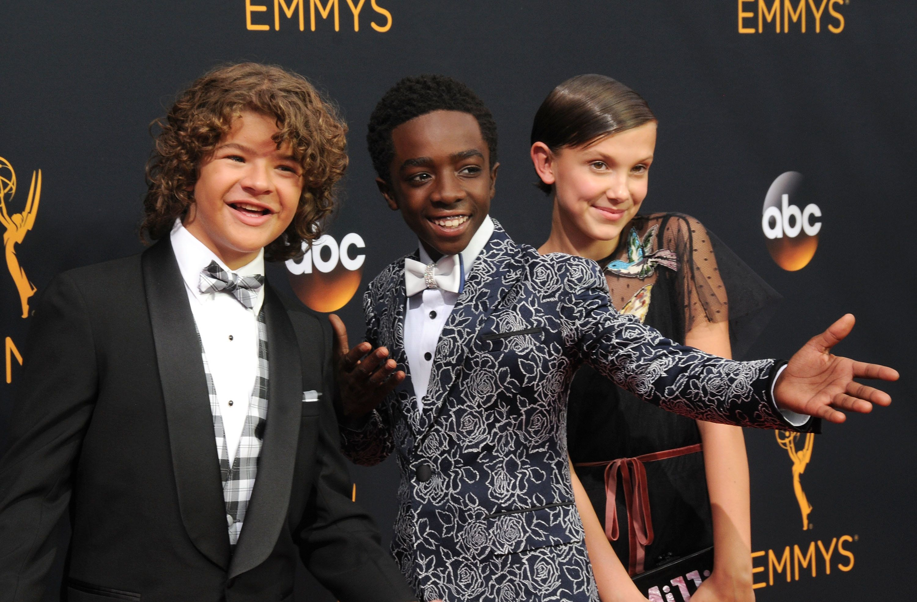 LOS ANGELES, CA - SEPTEMBER 18:  (L-R) Actors Gaten Matarazzo, Caleb McLaughlin and Millie Bobby Brown attend the 68th Annual Primetime Emmy Awards at Microsoft Theater on September 18, 2016 in Los Angeles, California.  (Photo by Barry King/Getty Images)