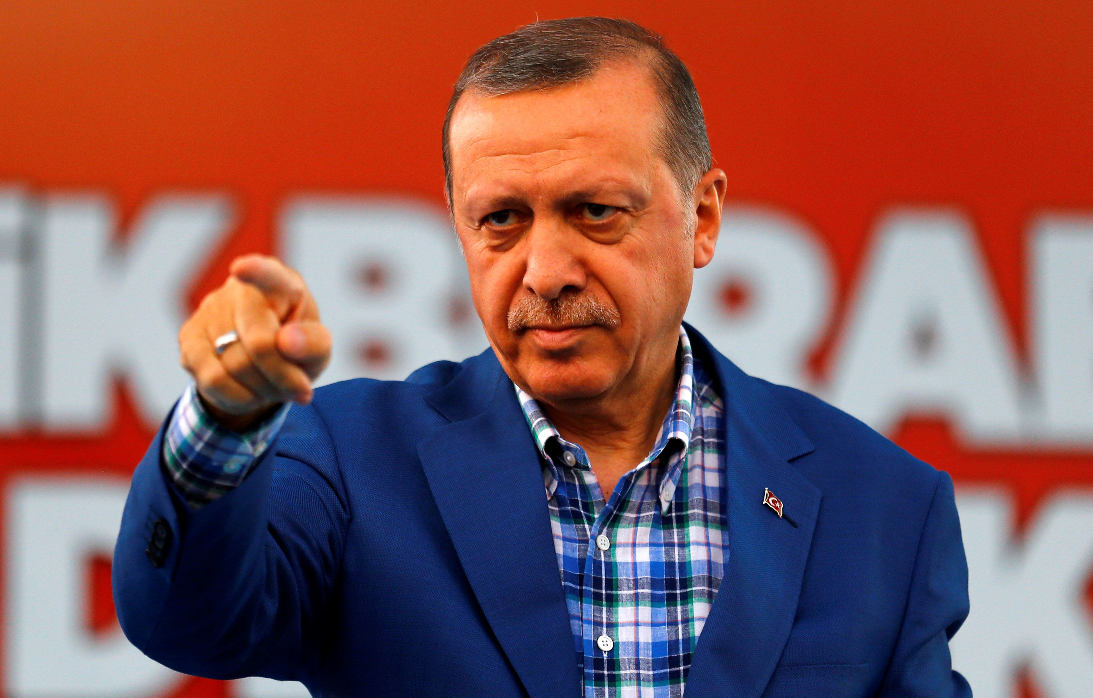 Turkey's President Tayyip Erdogan points at the United Solidarity and Brotherhood rally in Gaziantep, Turkey, August 28, 2016