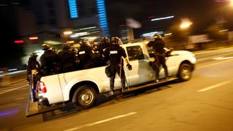 CHARLOTTE, NC - SEPTEMBER 22: Riot police race to intercept a large group of activists attempting to block traffic on Interstate 277 during a demonstration to protest the death of Keith Scott September 22, 2016 in Charlotte, North Carolina. Scott, 43,  was shot and killed by police officers at an apartment complex near UNC Charlotte. (Photo by Brian Blanco/Getty Images)
