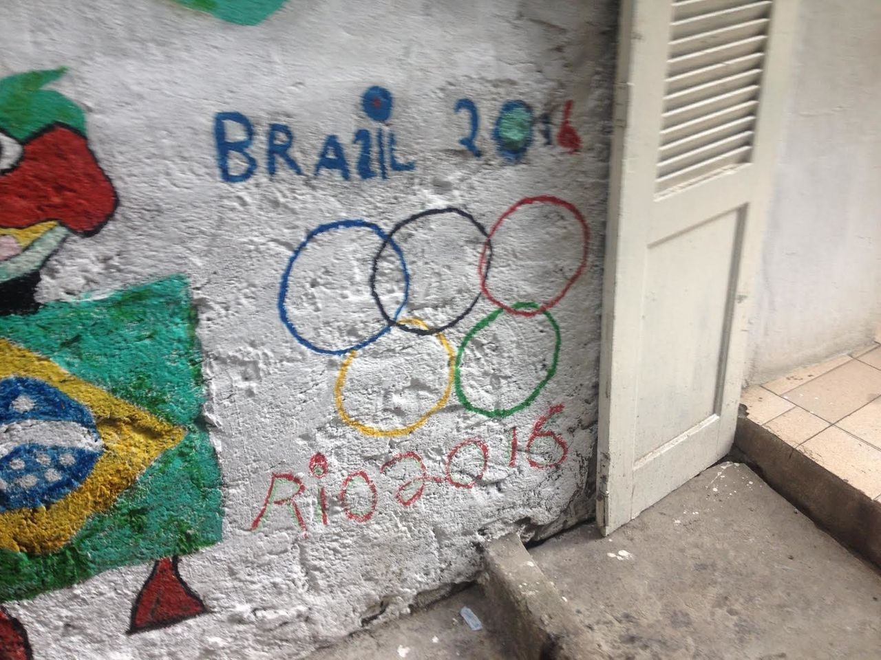 Street art in Rocinha, the largest of Rio de Janeiro's favelas, where people protested the depredations of the 2016 Olympic Games.