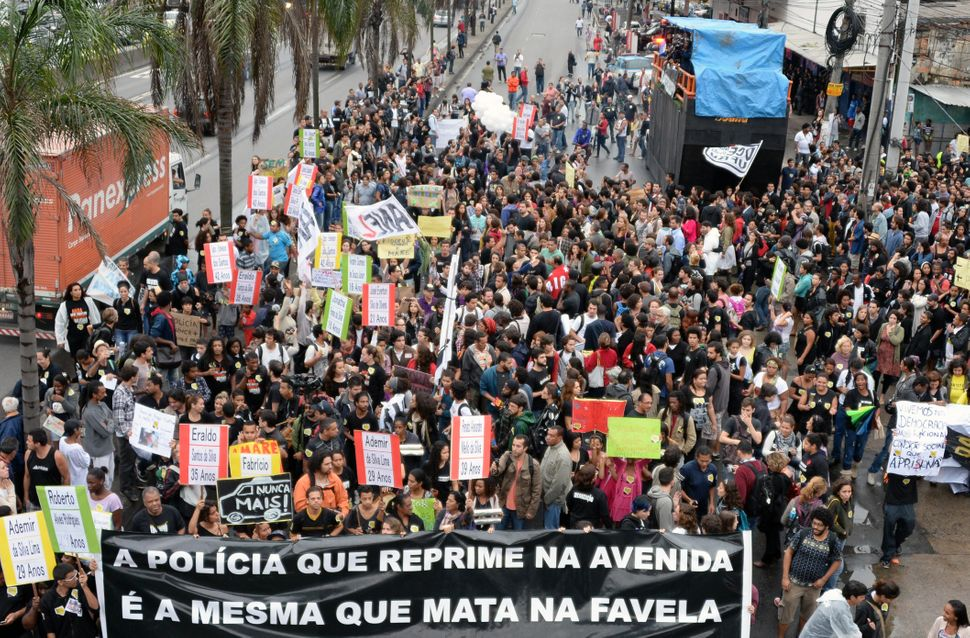 Residents of the Maré favela block a major avenue to demonstrate against police violence in July 2013.