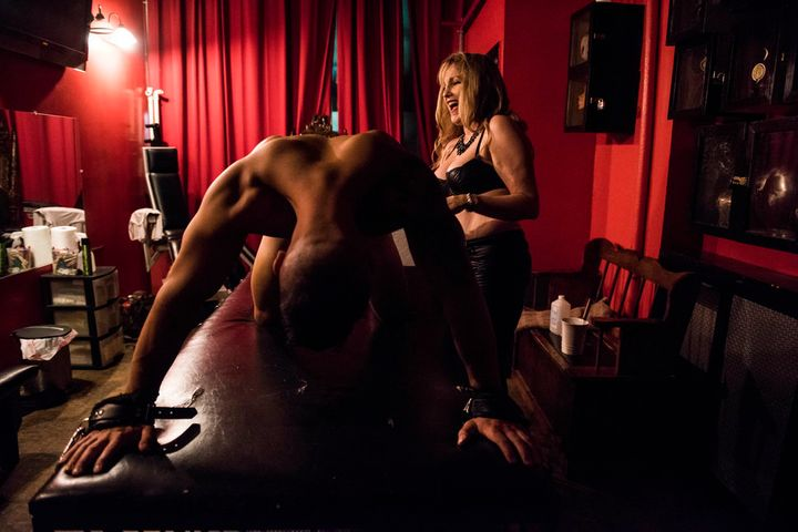 Sandra LaMorgese, a 60-year-old dominatrix, with a client.