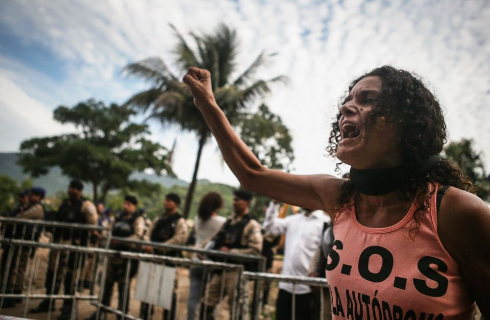 Residents of Vila Autódromo protest the demolition of their neighborhood in February